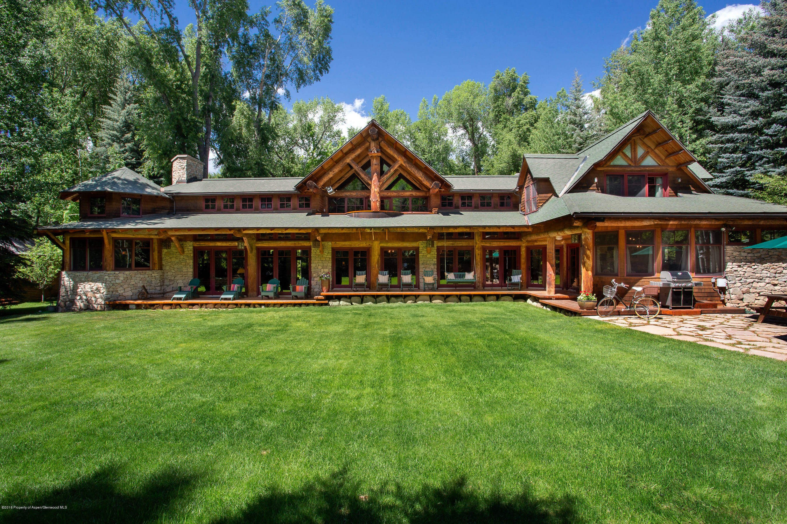OK Flats Log Home at 390 N. Spring St – Blocks to Downtown – Closes at $11.5M/$2,079 SF Part Furnished Image